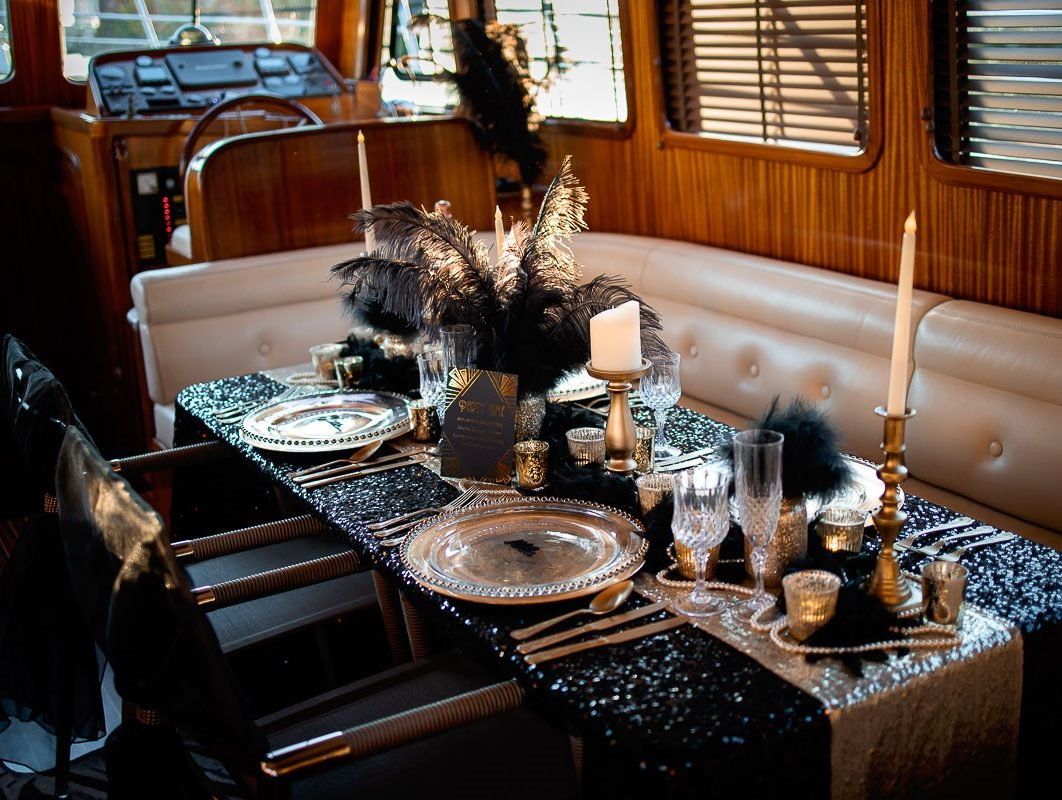 Black and gold feathers and fluff decorations for dinner party