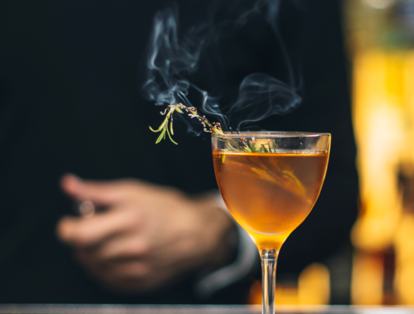 Burnt Rosemary floating on a drink