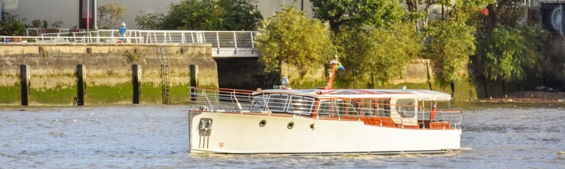Bourne Luxury Boat Sailing on Thames with South African and England Flag.
